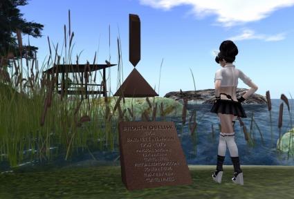 """Photograph of """"Virtual Broken Obelisk"""" a virtual world recreation of Barnett Newman's 1963 sculpture """"Broken Obelisk"""""""