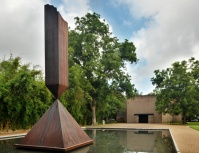 One of the physical versions of Barnett Newman's 1963 sculpture Broken Obelisk in a reflecting pool outside the Rothko Chapel in Texas.