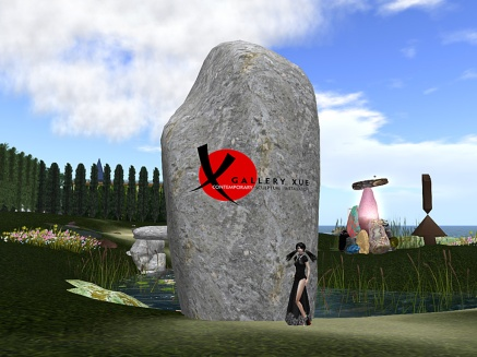 Gallery director Xue Faith at large megalith, the location of the site-specific collaborative scupture Cairn.