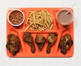 Image by photographer James Reynolds. A prison tray with the last meals, from elaborate chicken dinners, to a single olive, as requested by death row inmates.