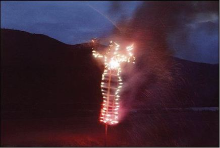 "Anima, by Ana Mendieta, 1976 - Image of a burning human shilouette, almost like the ""burning man"" but normal scale"